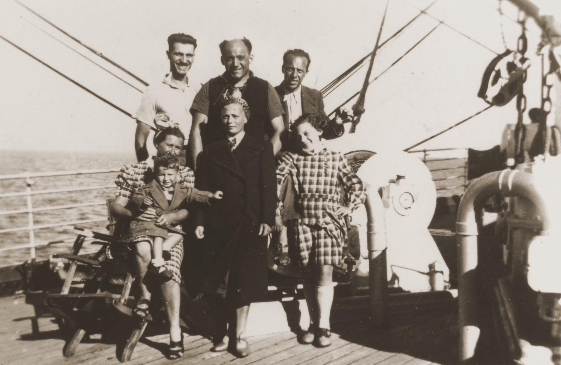 Austrian Jewish refugees pose on the deck of the SS Virgilio on their journey from Italy to Chile.  From Chile they traveled overland to their new homes in La Paz, Bolivia.  Among those pictured are members of the Reis, Rubinstein, and Kessler families.