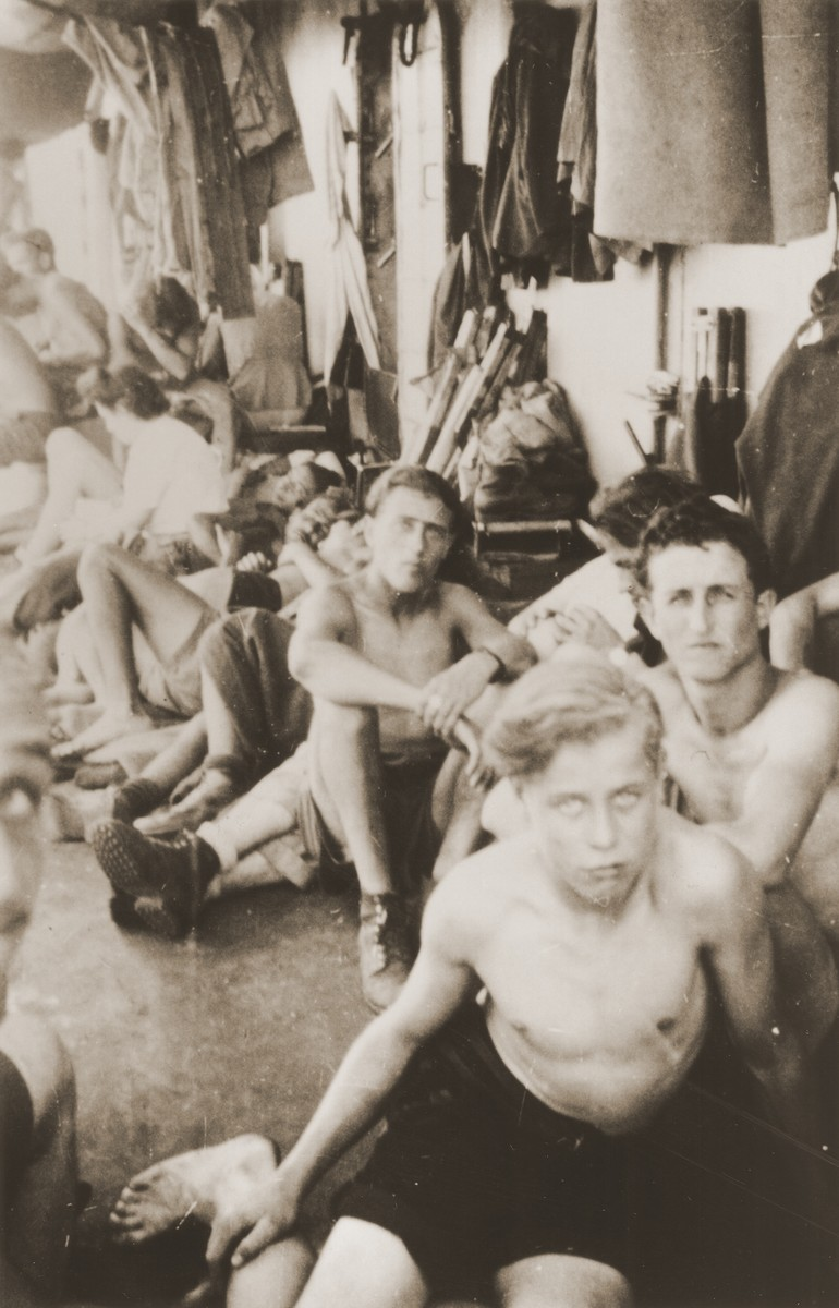 Jewish youth relax on the deck of the Mala immigrant during its voyage to the new State of Israel.  All were recruited into the Israeli army on the dock upon arrival.