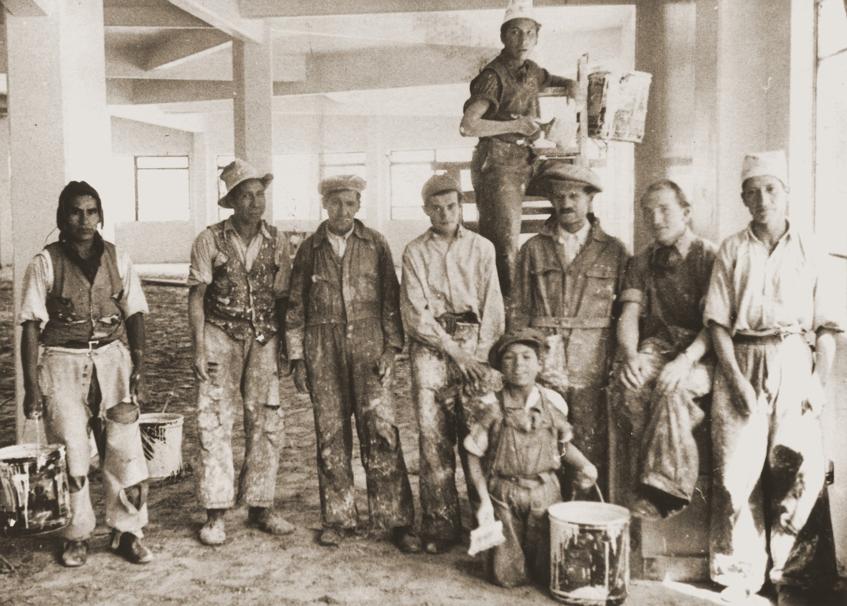 Austrian Jewish refugees pose with Bolivian workers at a construction site in La Paz.  Among those pictured are Nathan Wolfinger (third from the right) and Julius Wolfinger (fourth from the right).