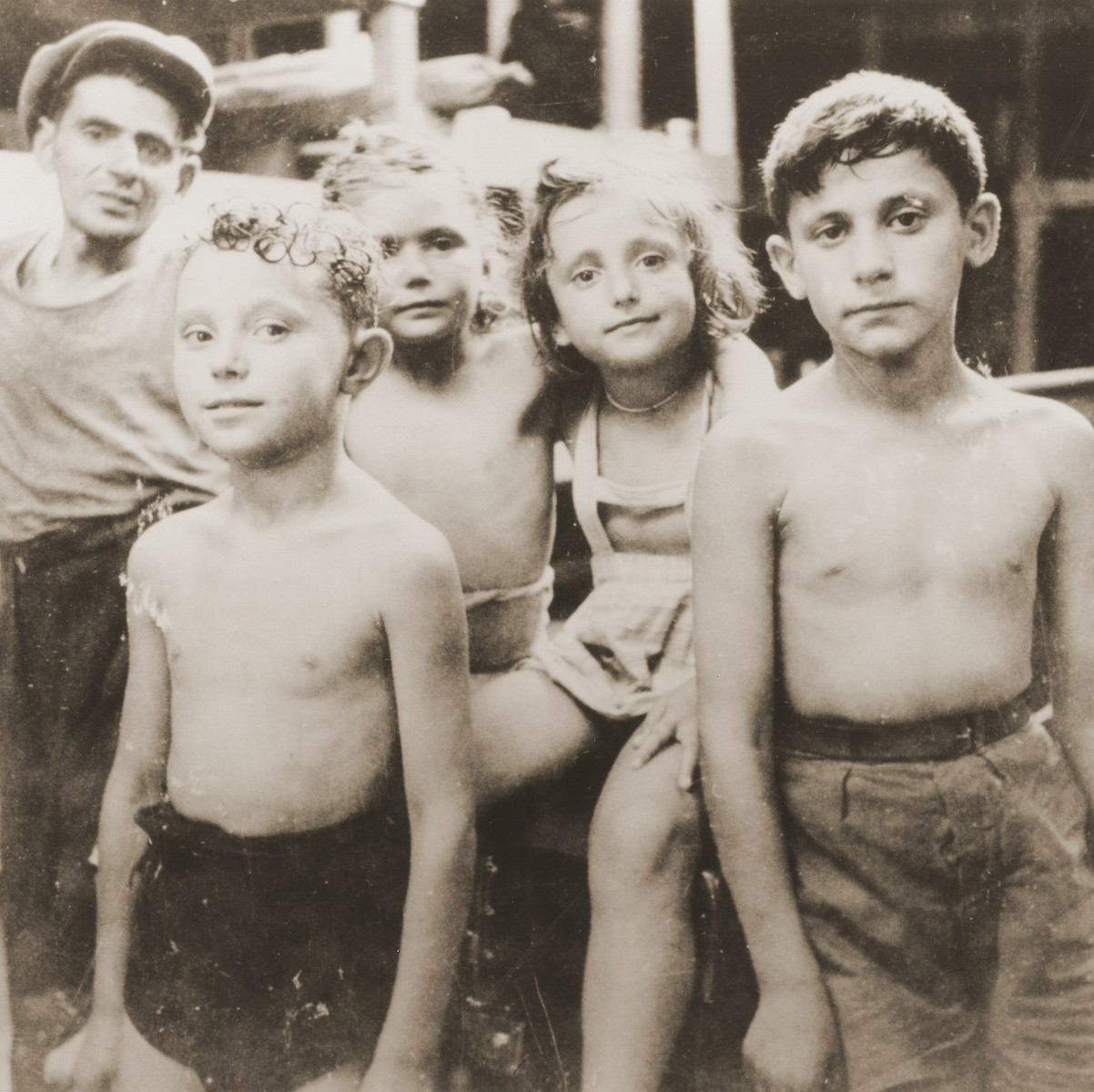 Group portrait of Jewish DP children on the deck of the Mala immigrant ship while en route to the new State of Israel.