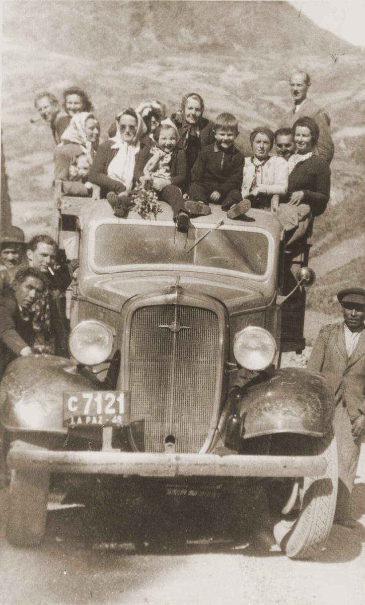 Austrian Jewish refugees pose on the back of a truck during an excursion to the Altiplano in Bolivia.  Pictured from left to right are:  Eugen and Rosie Spitzer; Ilse Jordan; Gisi, Otto and Eva Helfer; Berta Wolfinger; Leo Spitzer; unknown; Mr. and Mrs. Franco; and unidentified (behind).