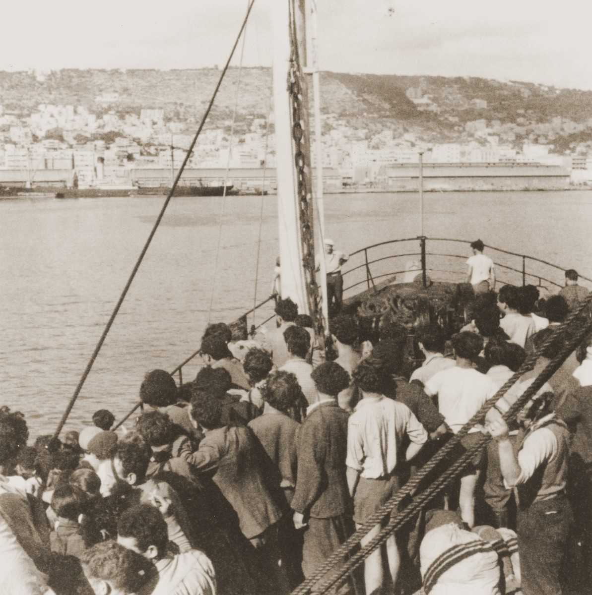 Passengers view Mount Carmel from the deck of the Mala immigrant ship as it enters the port of Haifa.  Acording to the donor, no attention was paid to the Egyptian aircraft's failed attempt to bomb the Mala.