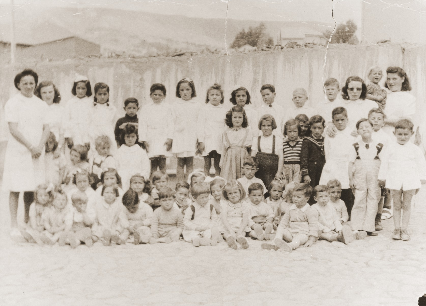 Kindergarten class at the Jewish Kinderheim in La Paz, Bolivia.  The Kinderheim was supported by funds from the JDC and SOPRO (Sociedad de protection immigrantes).  Leo Spitzer is pictured in the back row, (fourth from the right).
