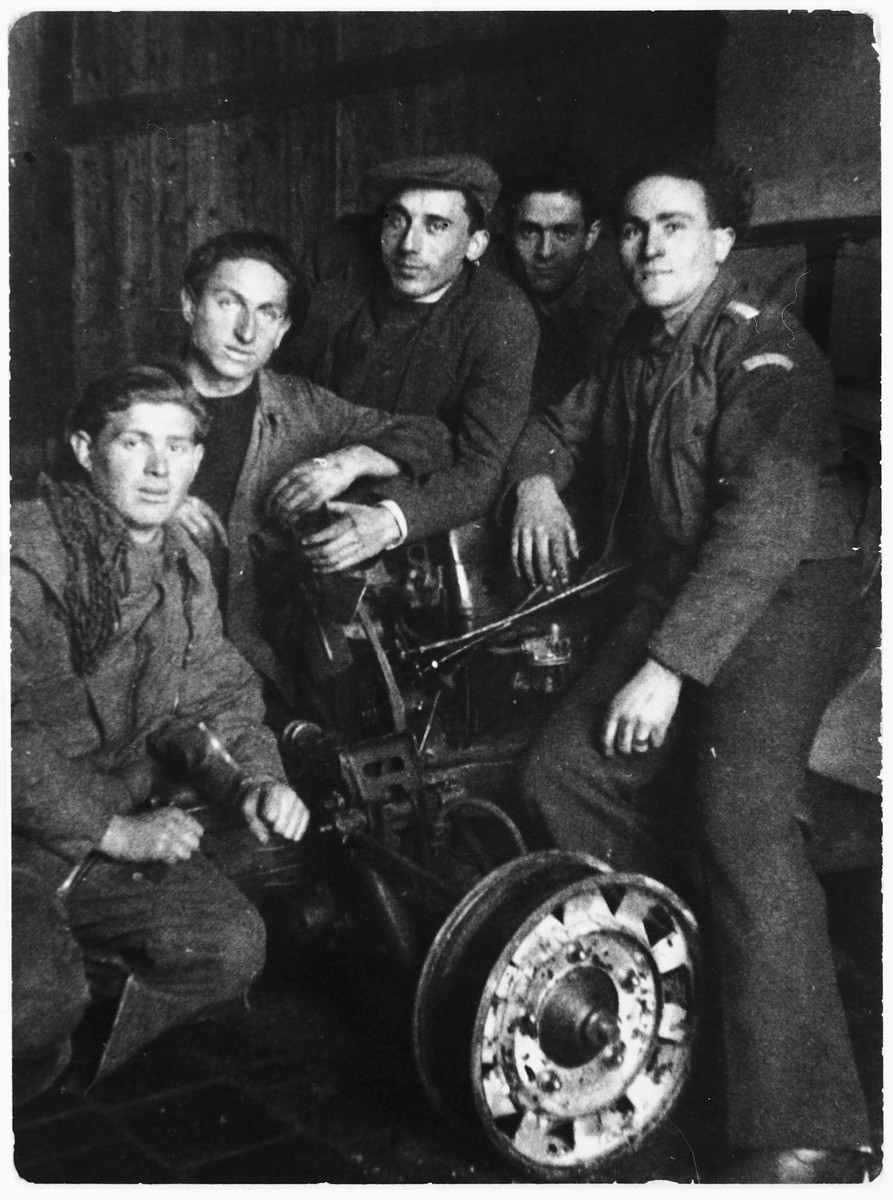 Group portrait of young Jewish DPs in an automotive vocational training workshop in the Gabersee displaced persons camp.  Among those pictured is David Wincygster (second from the right).