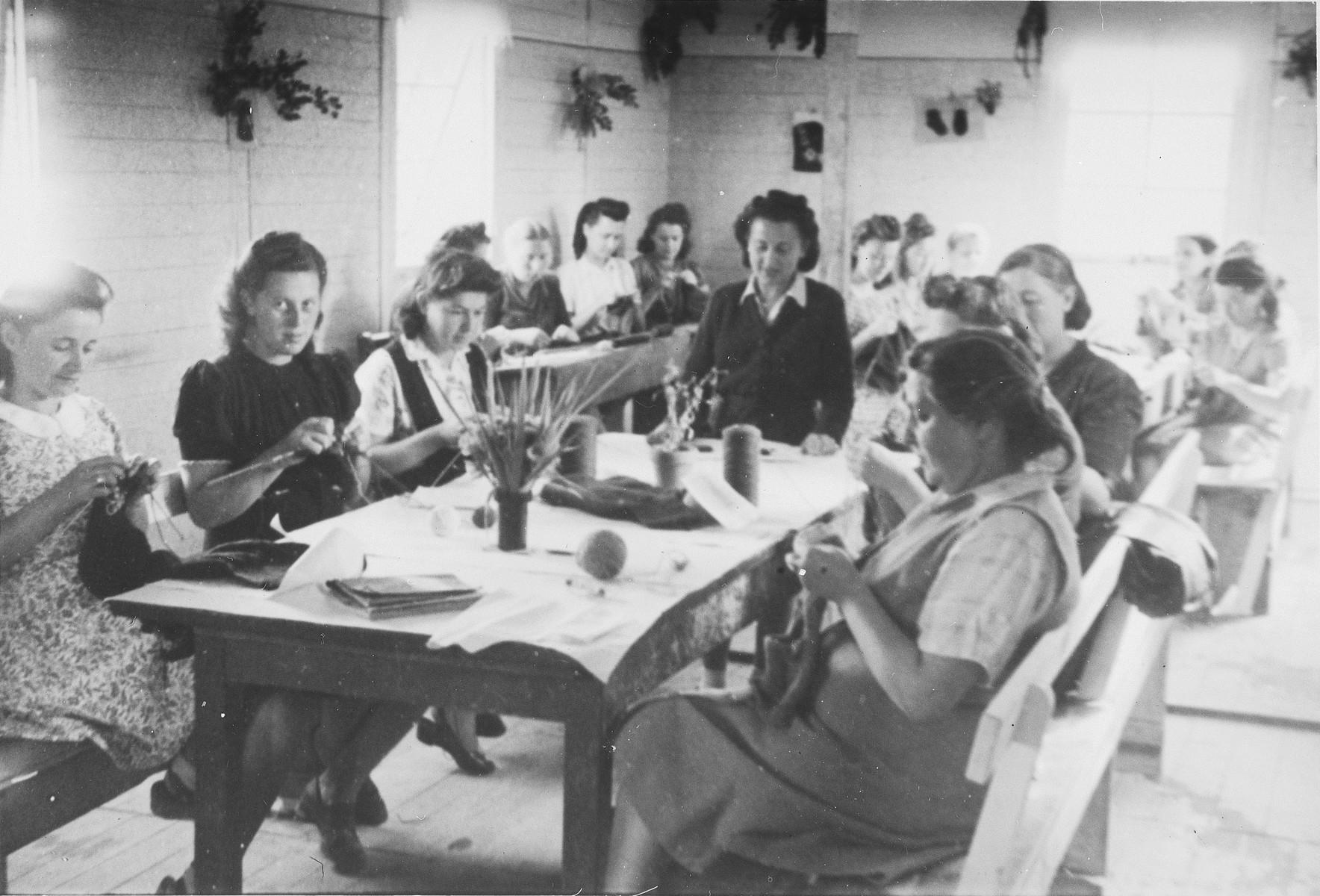 Women practice knitting in an ORT vocational school in Neu-Ulm.