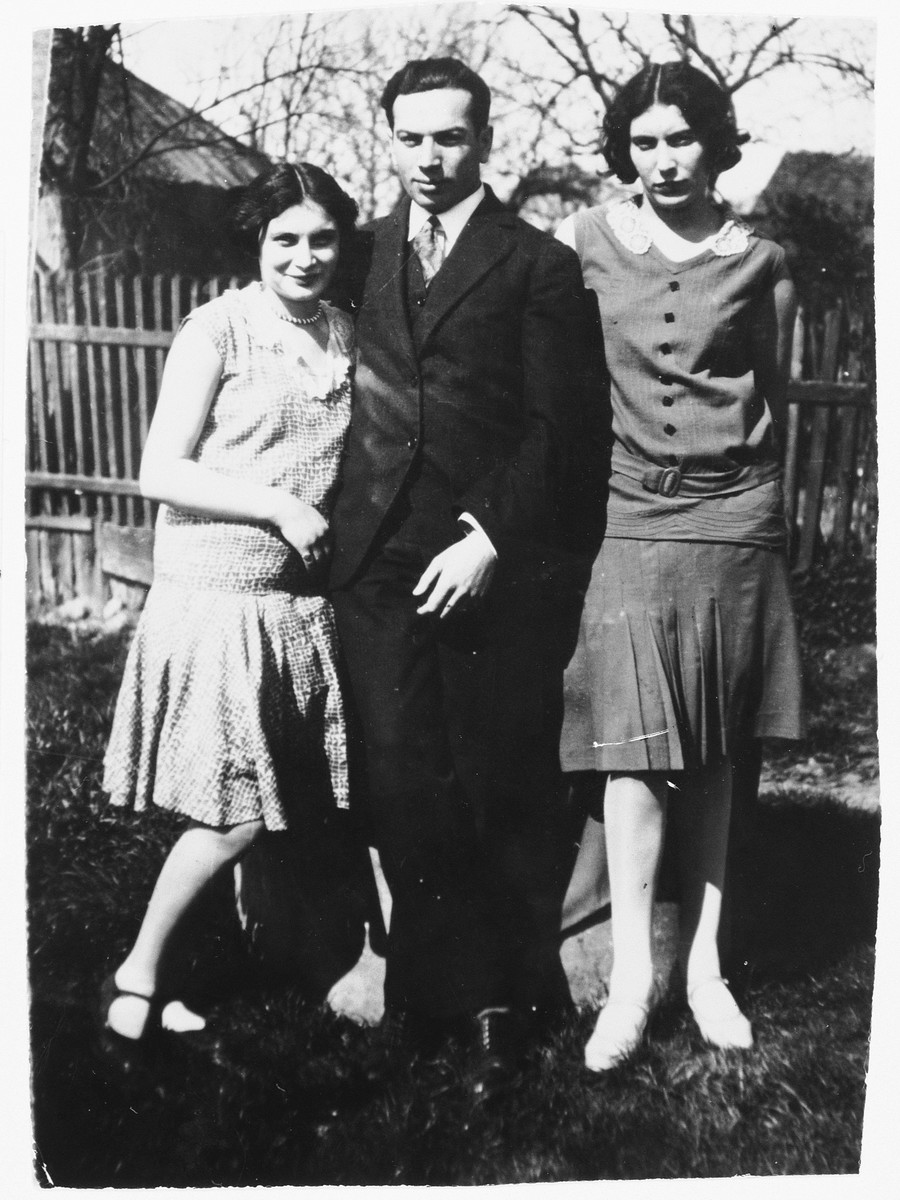 Portrait of the donor, Joseph Tuchfeld, with his two sisters in Rzeszow, Poland.  He survived the war by fleeing to the Soviet Union, where he found refuge in Bukhara.