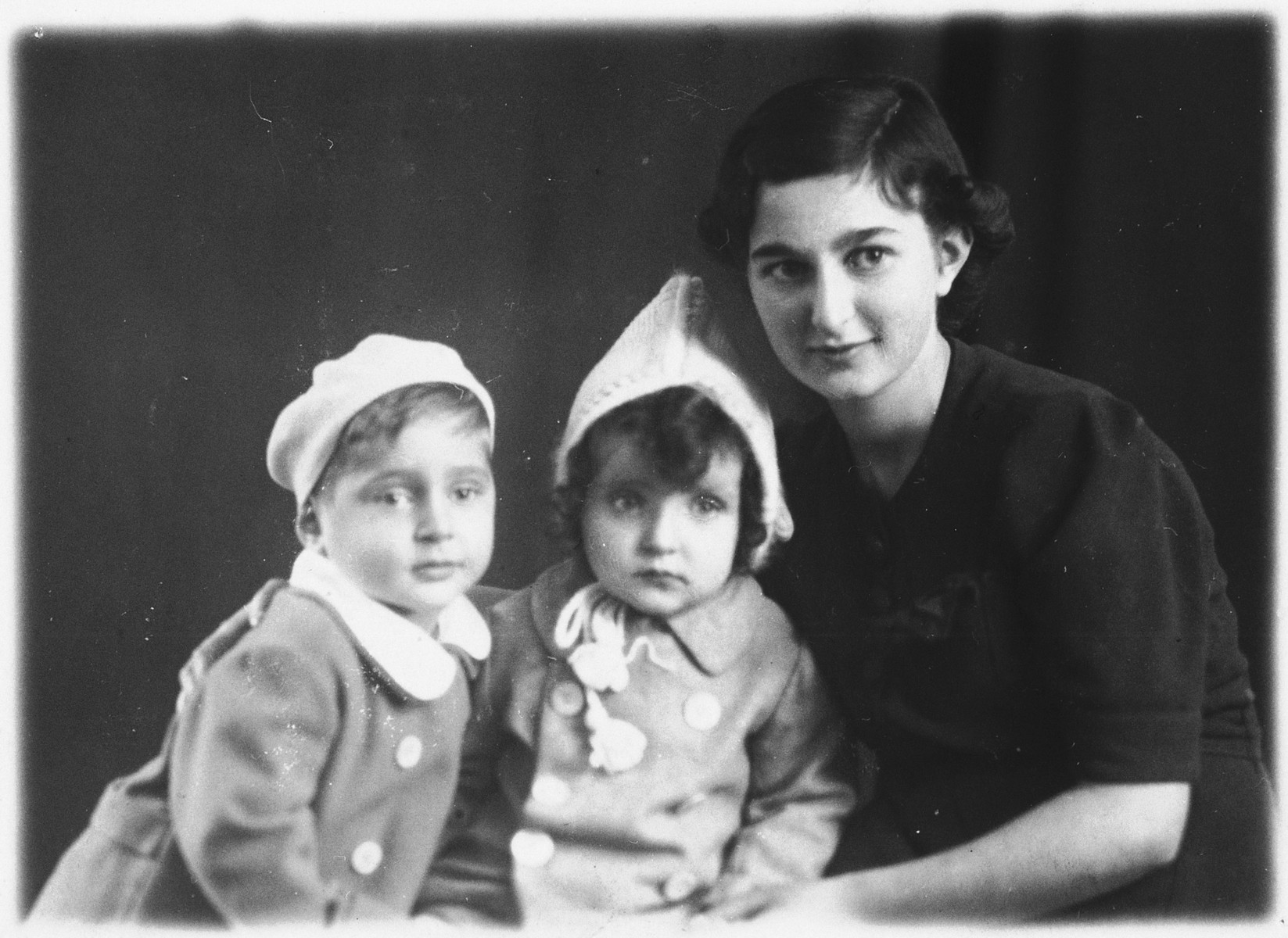 Studio portrait of a Jewish woman with two of her children.  Pictured are Mathilde Hirsch and her two youngest children, Werner and Rosalene.