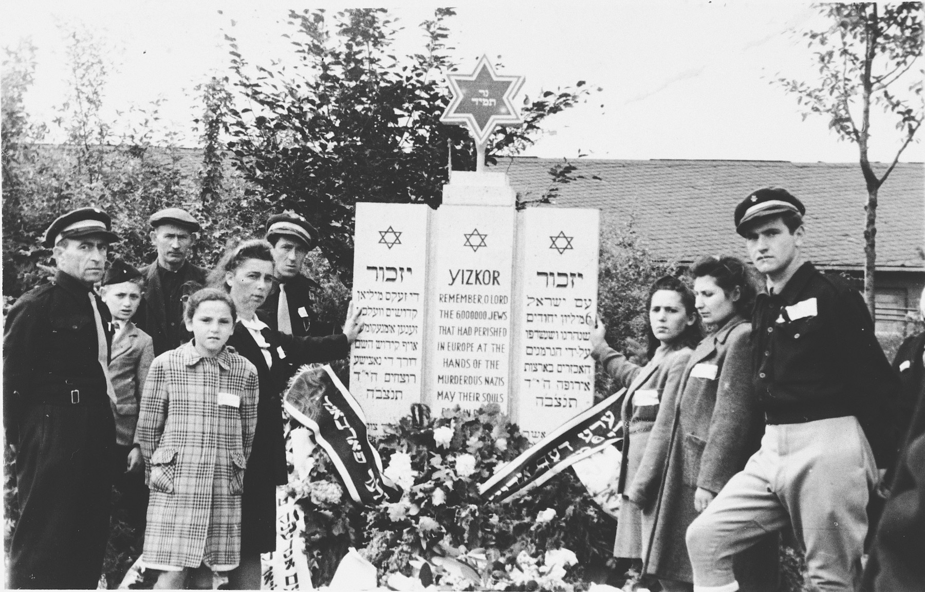 Survivors attend a memorial ceremony in the Hasenecke displaced persons camp.  Pictured on the left is Renia Pilzer and her aunt, Nette Goldman.