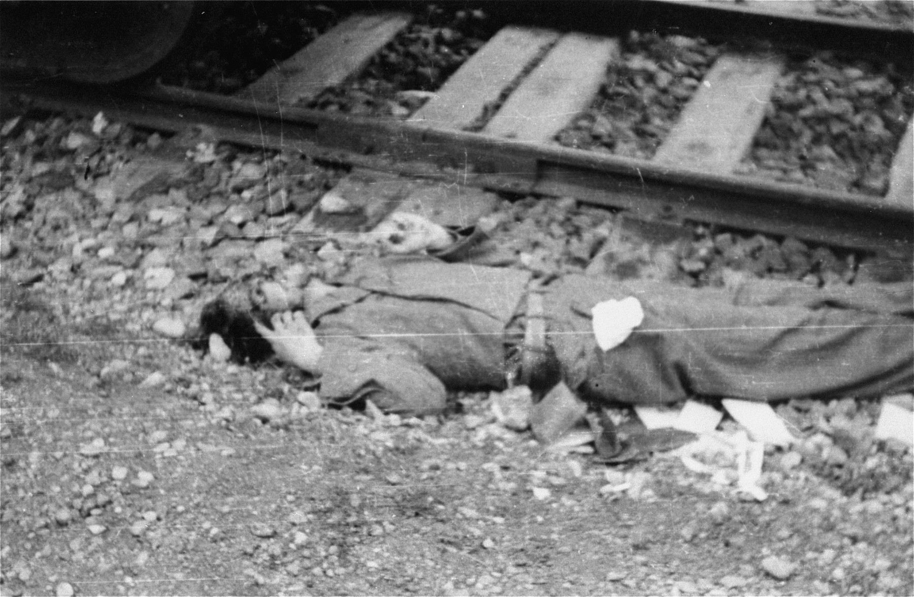 The body of an SS guard next to the railroad track.