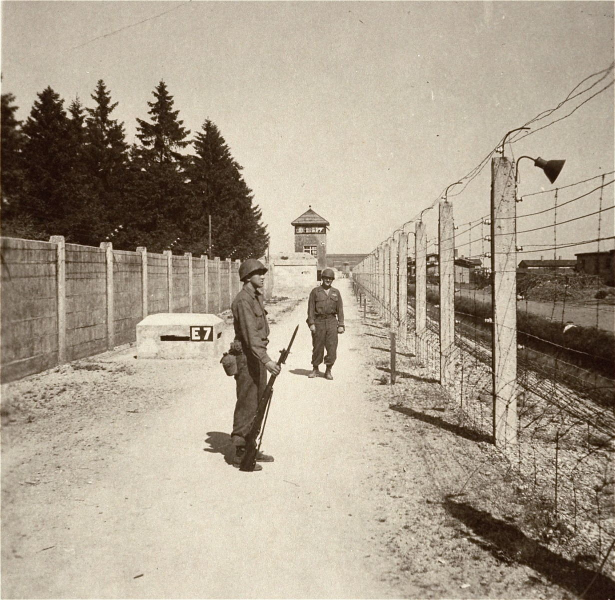American liberators stand guard at Dachau.