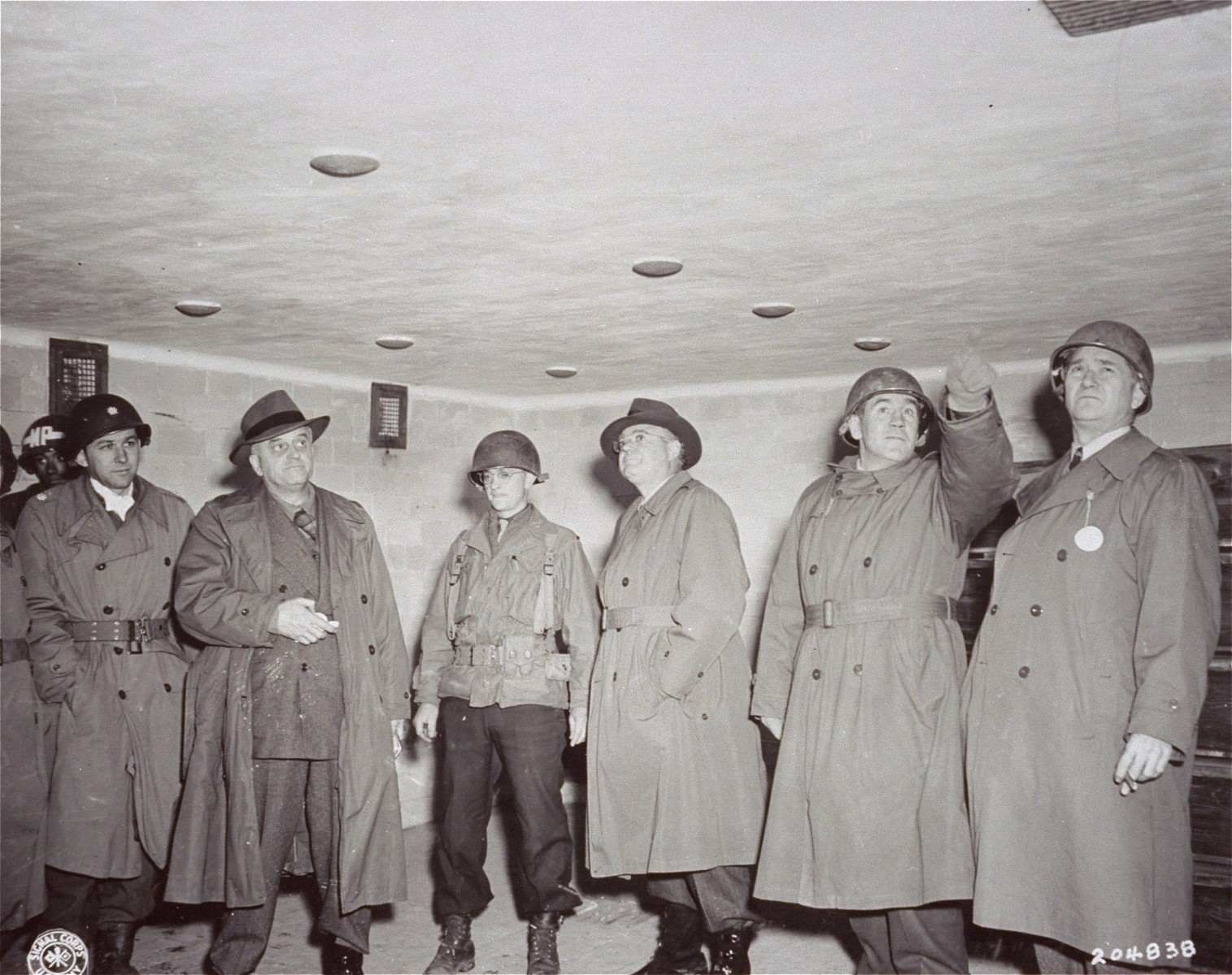 Members of a congressional group investigating German atrocities inspect the gas chamber in Dachau.    In the group are Senator Kenneth S Wherry, Senator. C. Wayland Brooks, Representative John M. Vorys, and Senator James P. Richards.