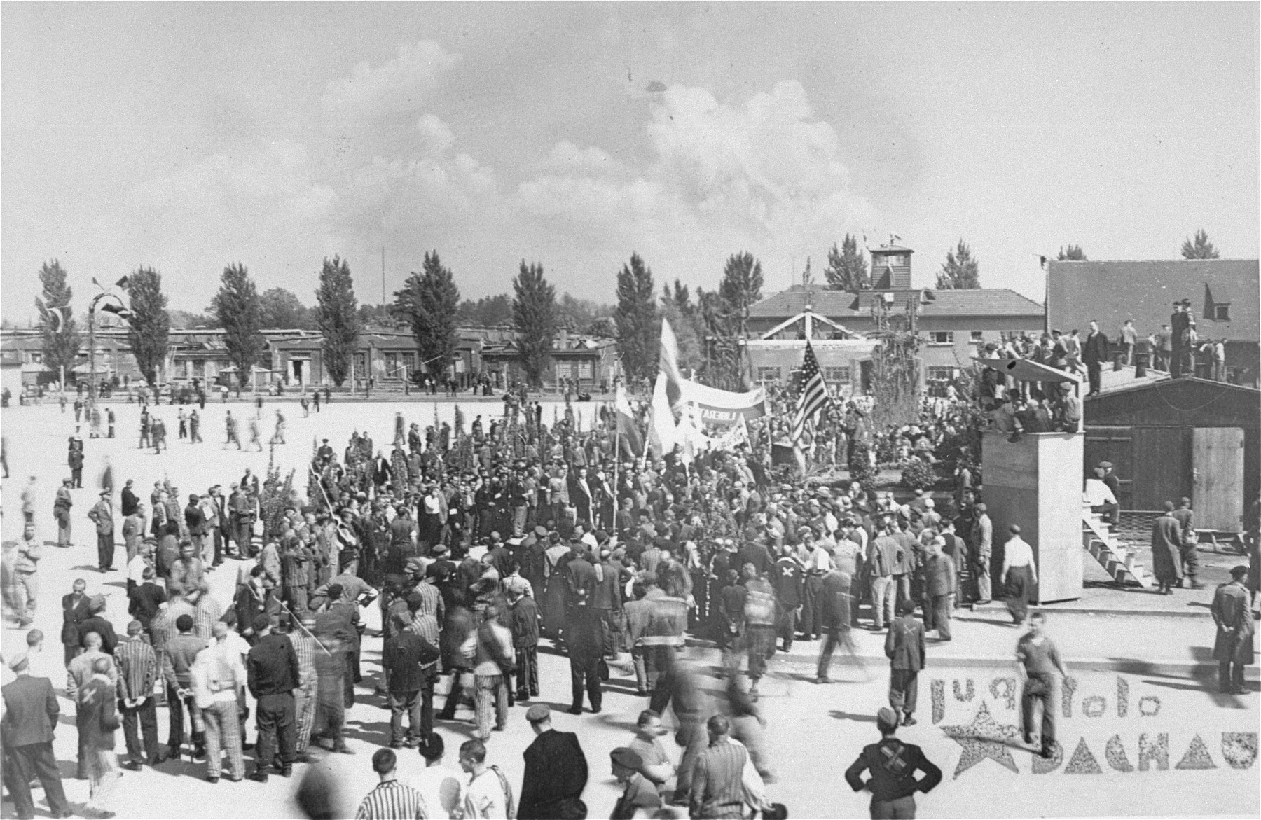 Survivors gathering to salute American liberators and remember their comrades who perished in Dachau.