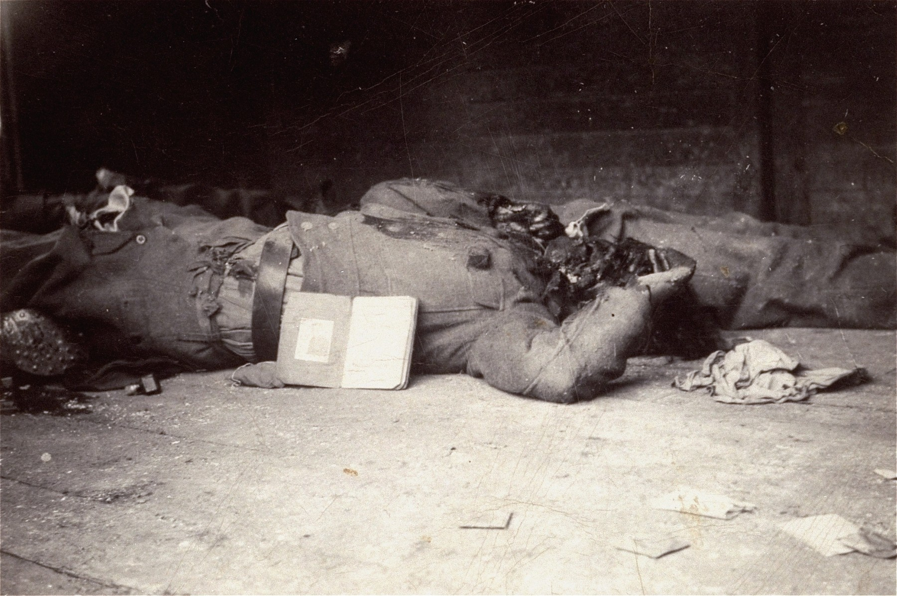 The corpse of an SS guard in Dachau.