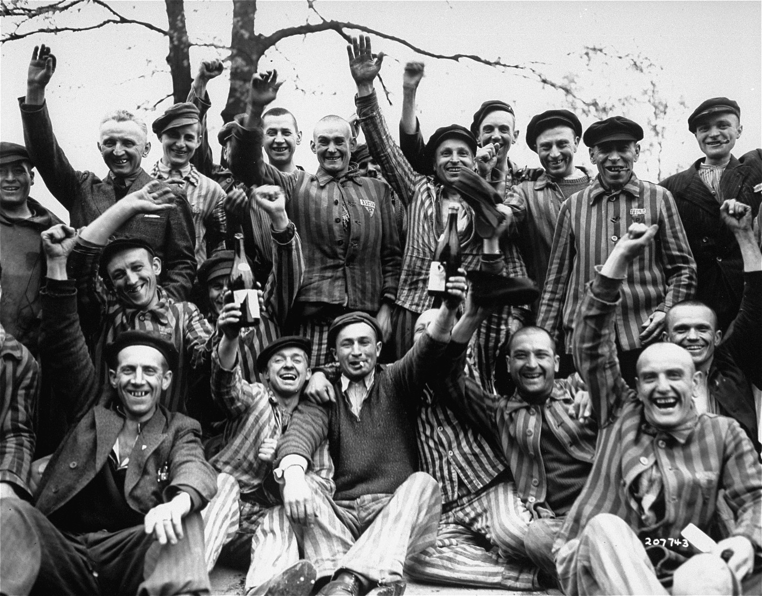 Polish prisoners in Dachau toast their liberation from the camp.