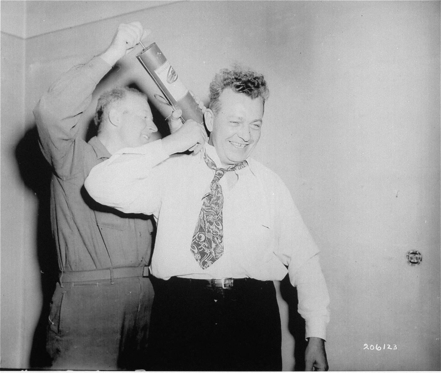 U.S. Congressman Everett M. Dirkson III is sprayed with DDT before entering Dachau for an inspection.