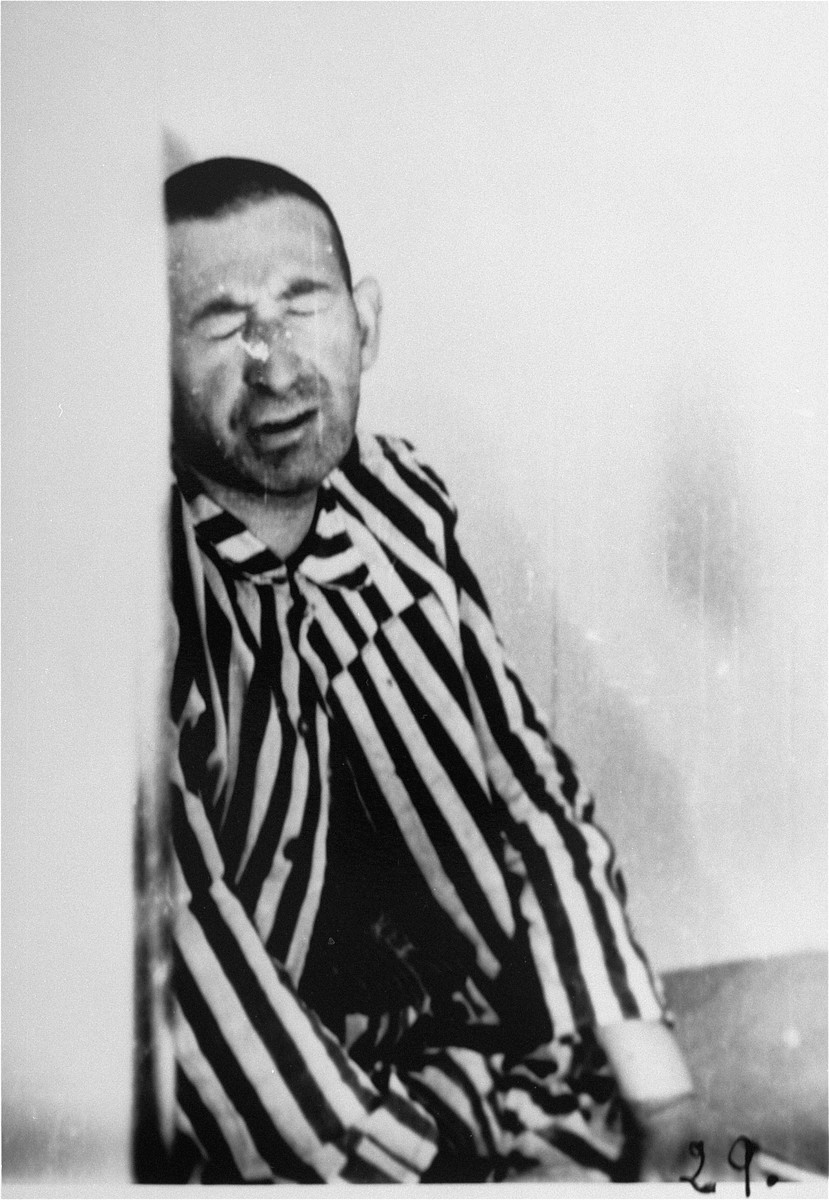 A prisoner in a special chamber responds to changing air pressure during high-altitude experiments.  For the benefit of the Luftwaffe, conditions simulating those found at 15,000 meters in altitude were created in an effort to determine if German pilots might survive at that height.