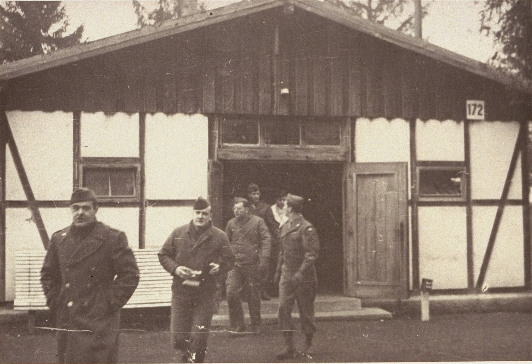 "American soldiers inspect the site of the first crematorium in Dachau.  The inscription on the back of the photograph reads, ""Nov. 18, 1945.  Dachau, Germany.  Dachau Concentration Camp.  First crematory at camp.  Others added to handle rushing business."""