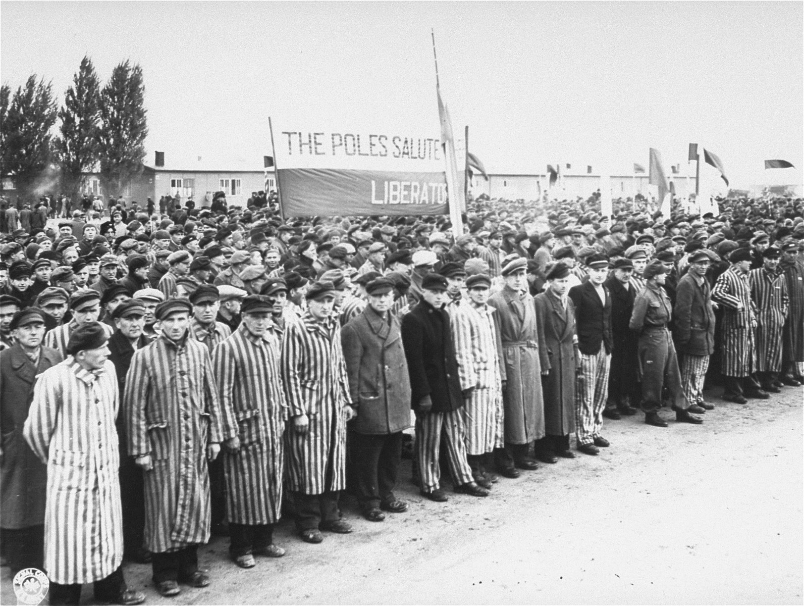 Survivors gather to salute the Allies and remember comrades who perished in Dachau.