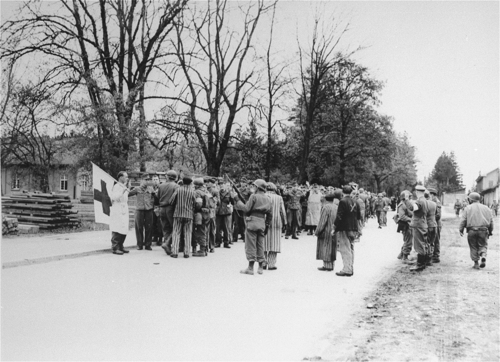 SS personnel in Dachau surrender to troops of the 45th U.S. Infantry Division.