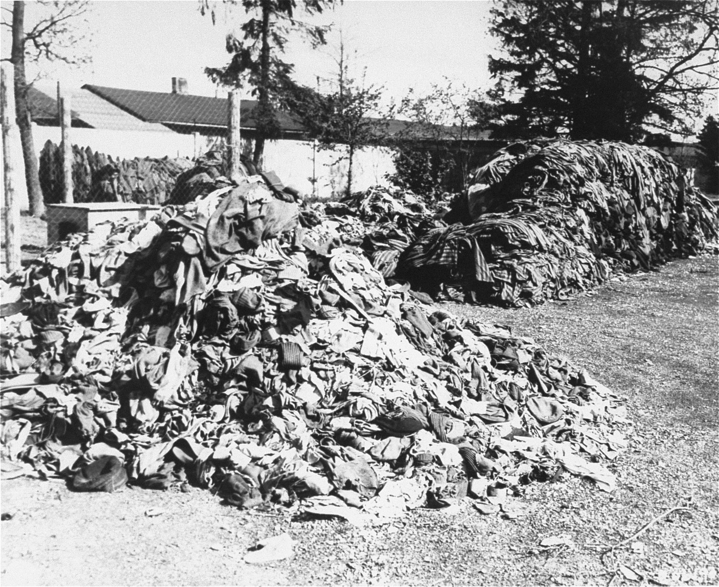 Prisoners' clothing is piled outside at the newly liberated Dachau concentration camp.