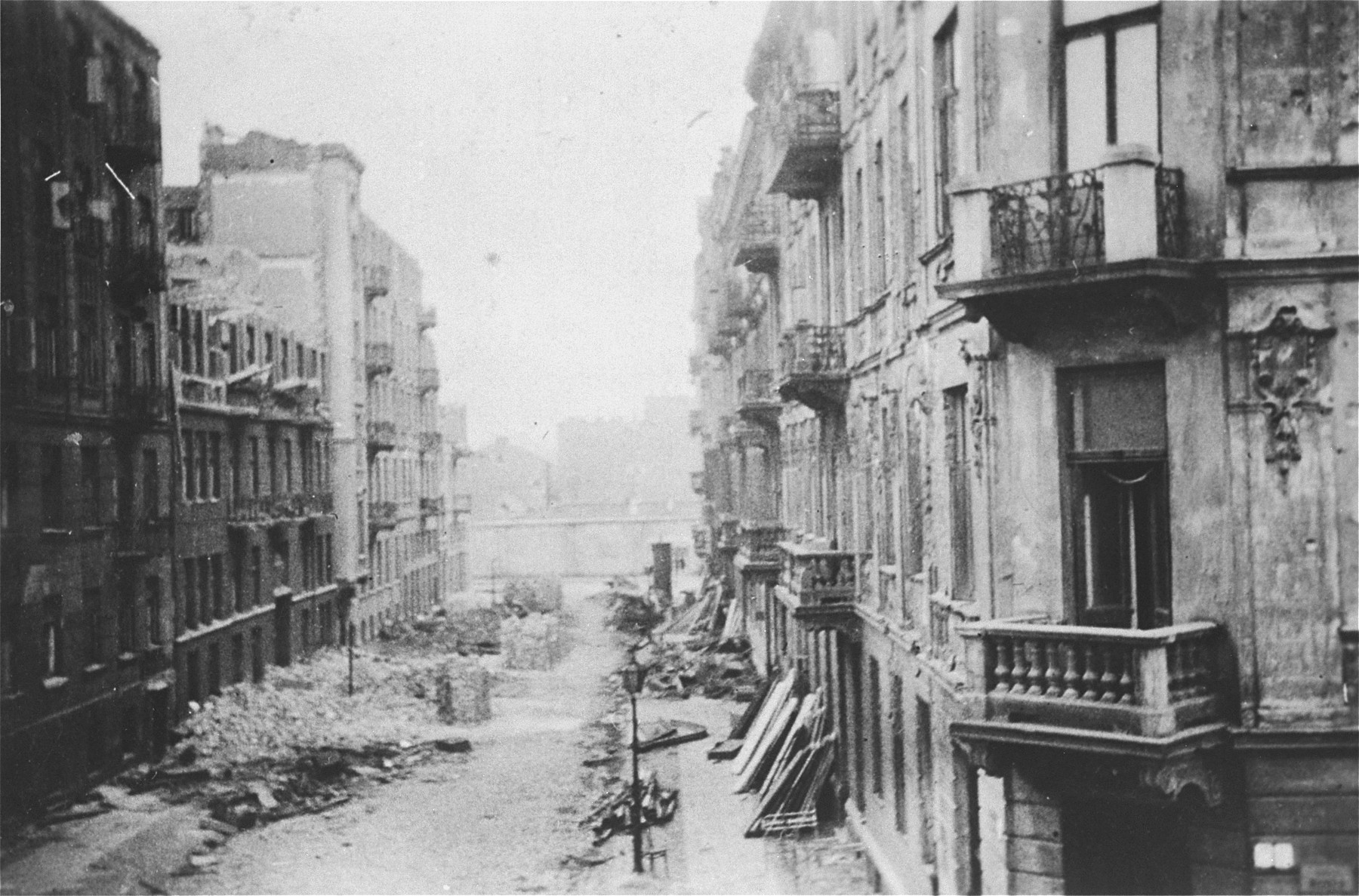 A debris filled street in the Warsaw ghetto, photographed during the suppression of the uprising by the SS.
