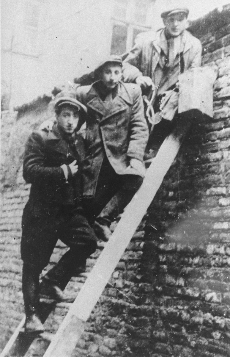 Jewish smugglers waiting for a delivery from the Aryan side.