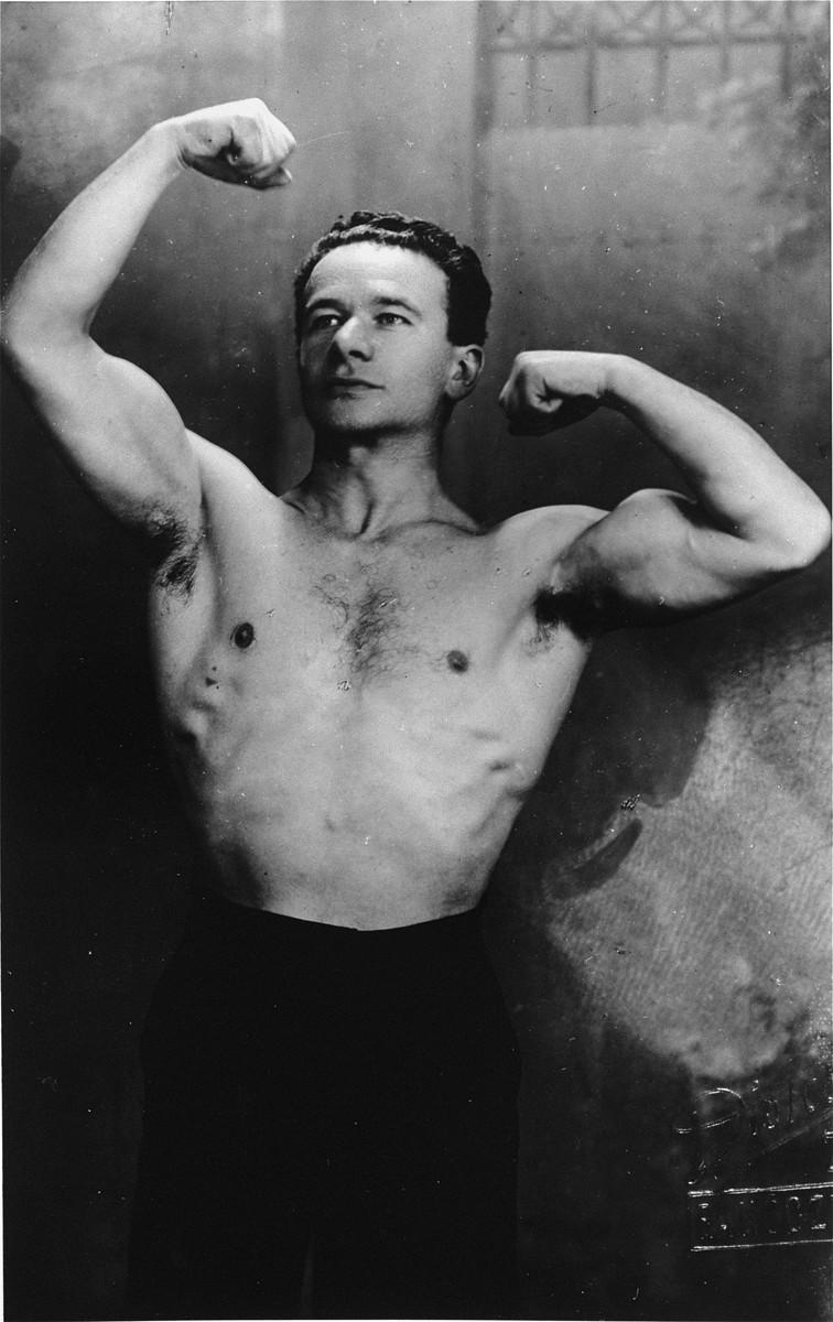 Portrait of Dr. Jozsef Szalai flexing his muscles.