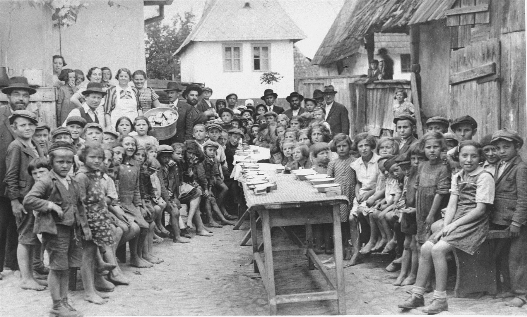 Group portrait of Jewish children at a JDC sponsored soup kitchen in Tacovo.