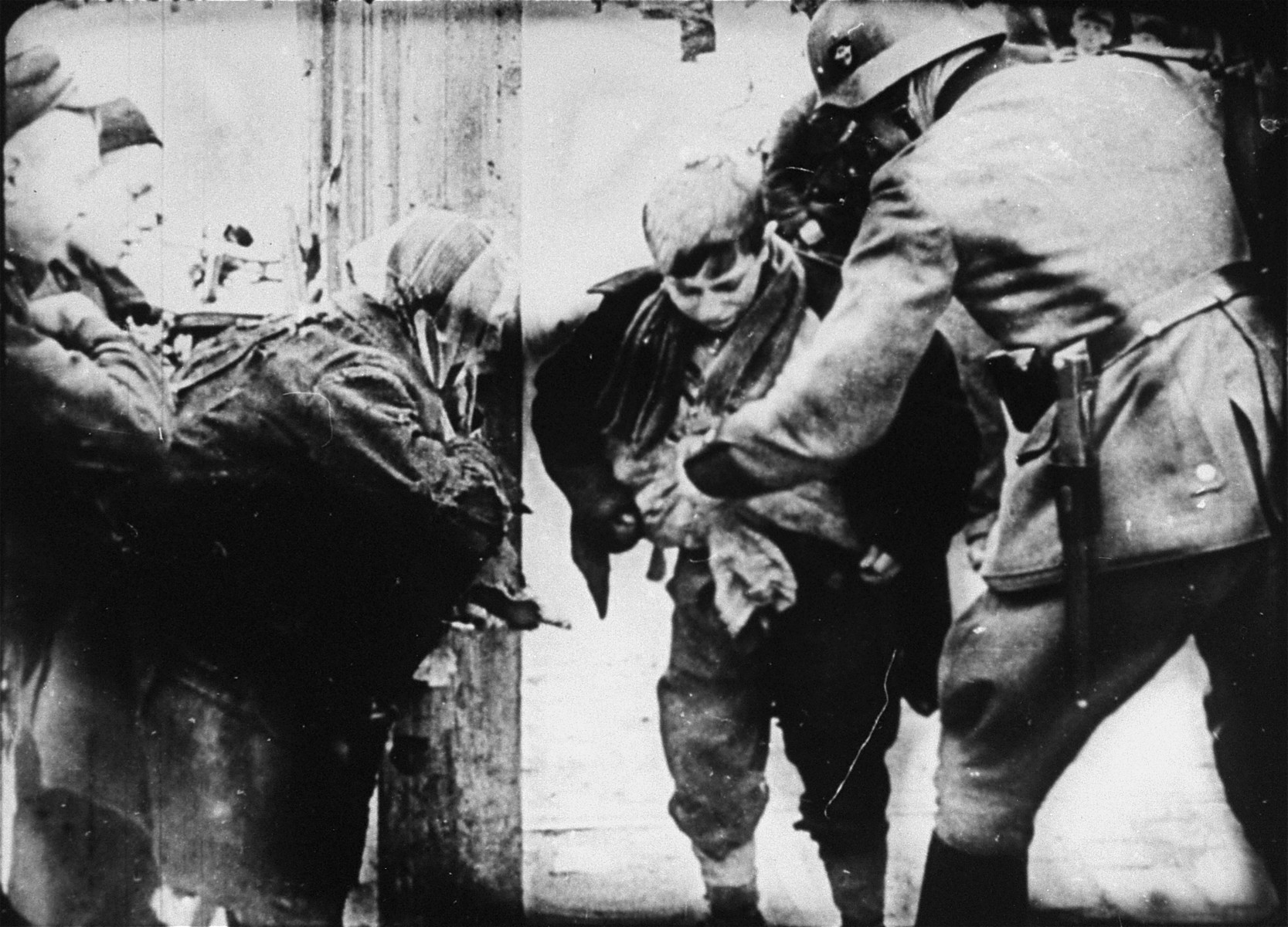 A young boy is caught smuggling in the Warsaw ghetto by a German policeman.