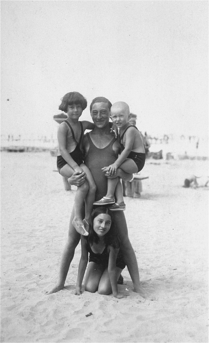 Members of the Kornhauser family pose on the beach at Lake Balaton, near Budapest.    Pictured is Endre Kornhauser, who is holding Janos and Tamas in his arms.  Below them is Lilly.