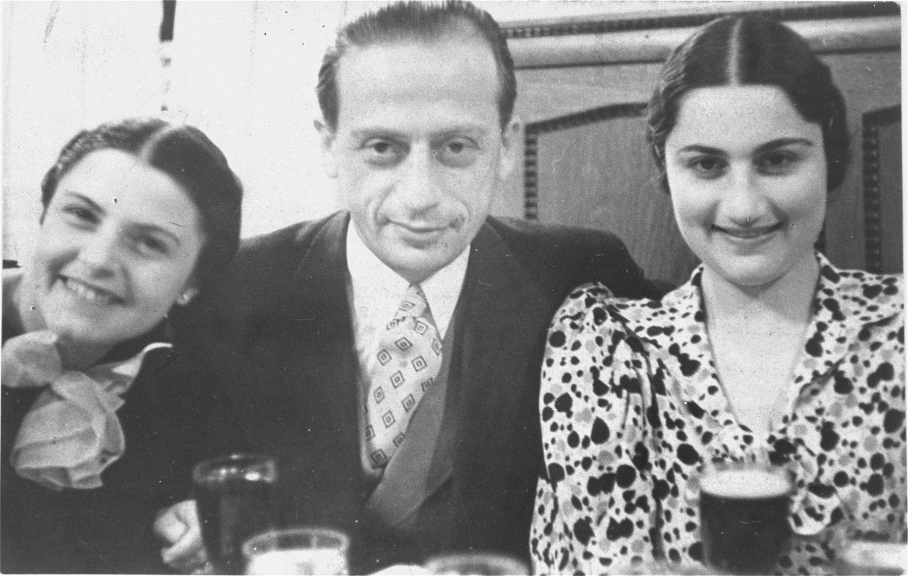 Portrait of three Hungarian Jews at a restaurant in Szeged.  Pictured are Leo Liebmann with his two sisters-in-law, Szenka  Liebmann (left) and Mariska (right).