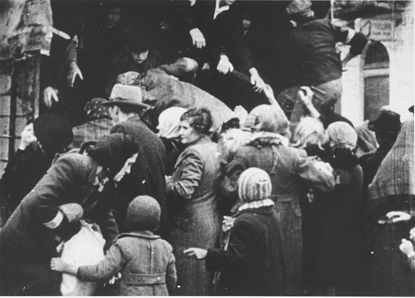 Jews captured by the SS during the suppression of the Warsaw ghetto uprising are forced to board a truck that will likely take them to a labor camp.   Most of the people captured during the ghetto uprising were deported to Treblinka, however, some were sent to either Trawniki or Poniatowa.