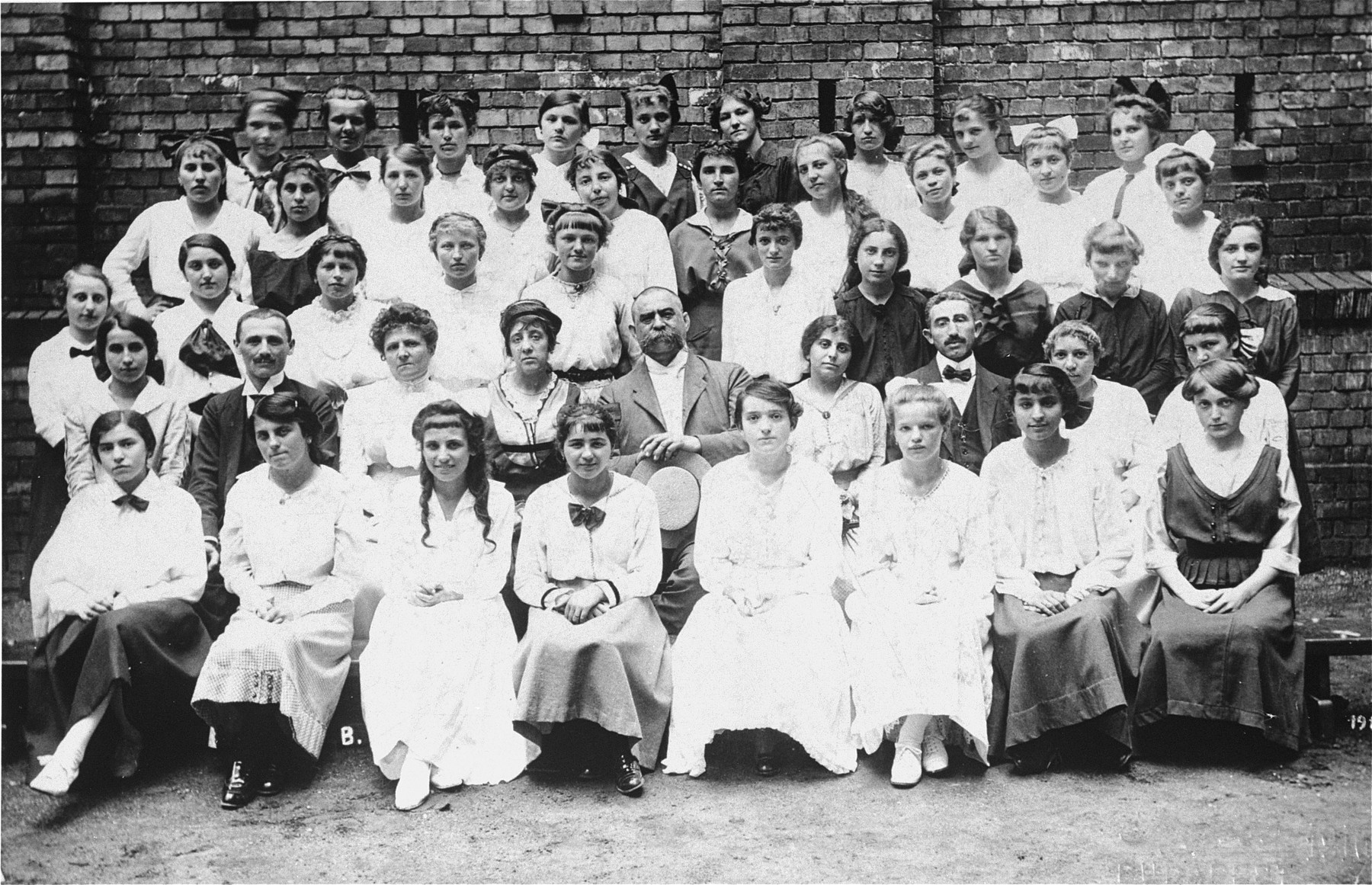 Group portrait of the faculty and students at a secretarial school in Budapest.  Among those pictured is Margit Kornhauser.