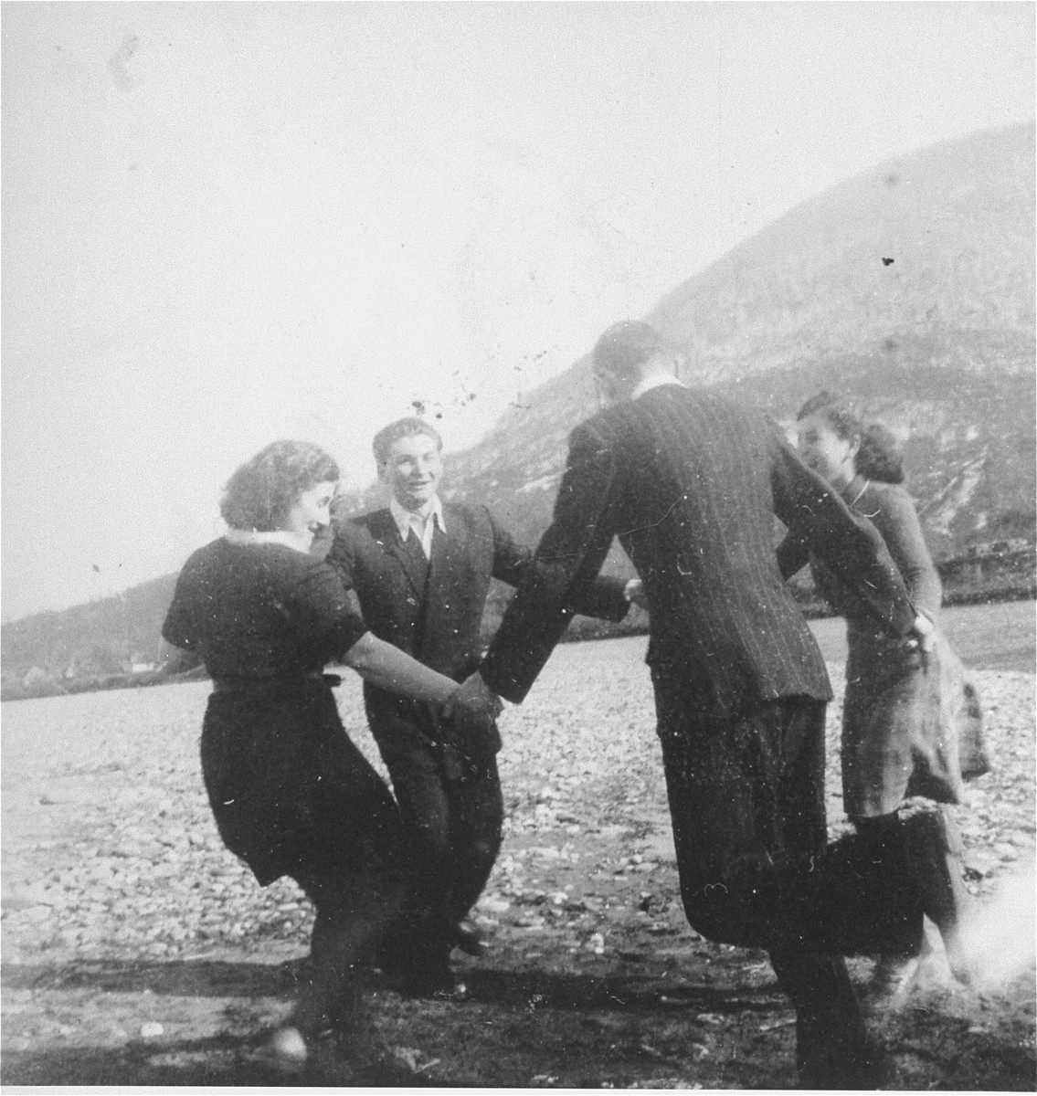 Members of the Hanoar Hatzioni Zionist youth movement in Tacovo, dance on the shore of the river Tissa.  Among those pictured are Frimet Ickovic.