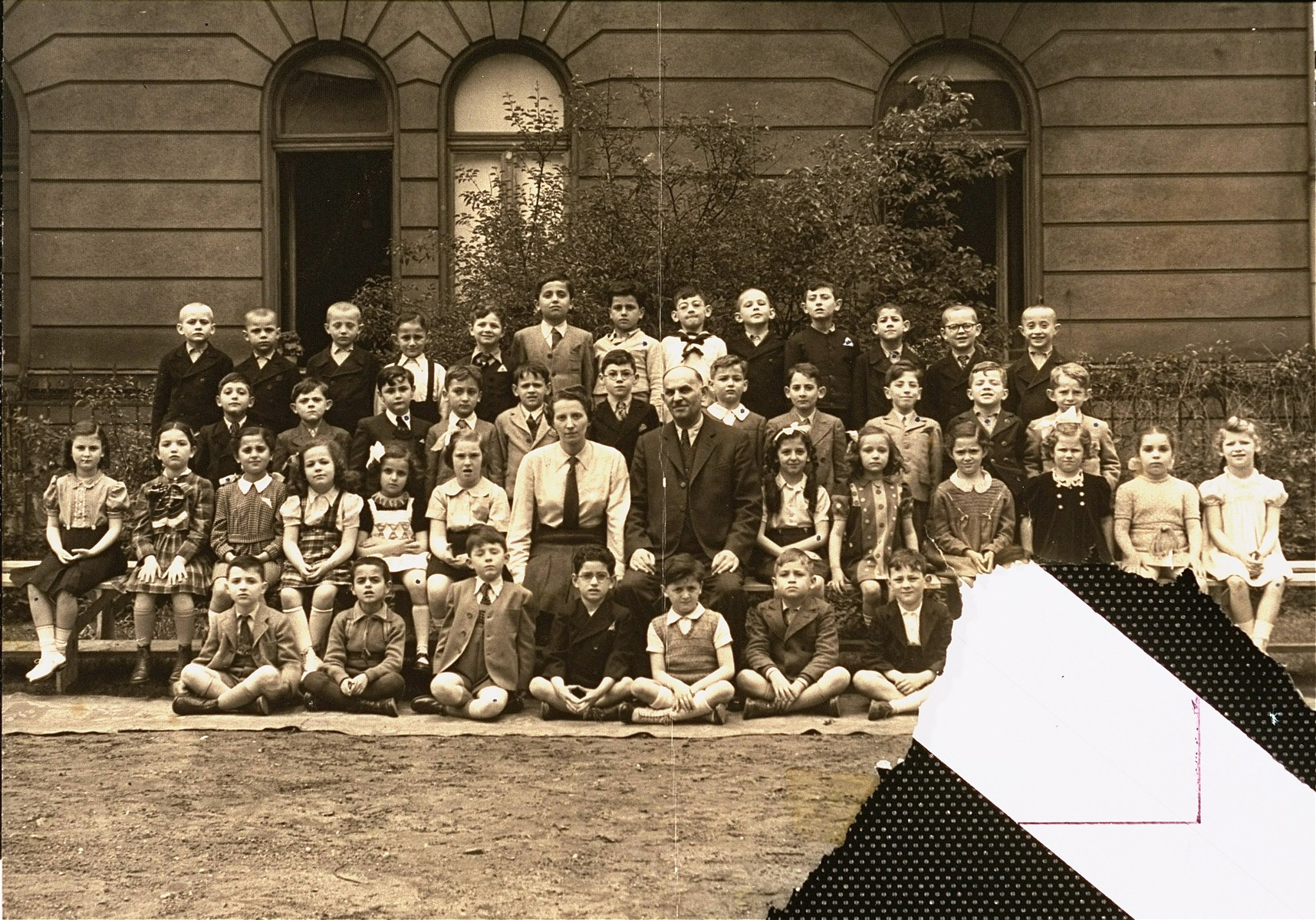 Class photograph of the first grade at the Jewish Boys' Orphanage School of Budapest (Zsido Fiu Arvahaz), a Jewish primary school attended by both orphaned and non-orphaned children.