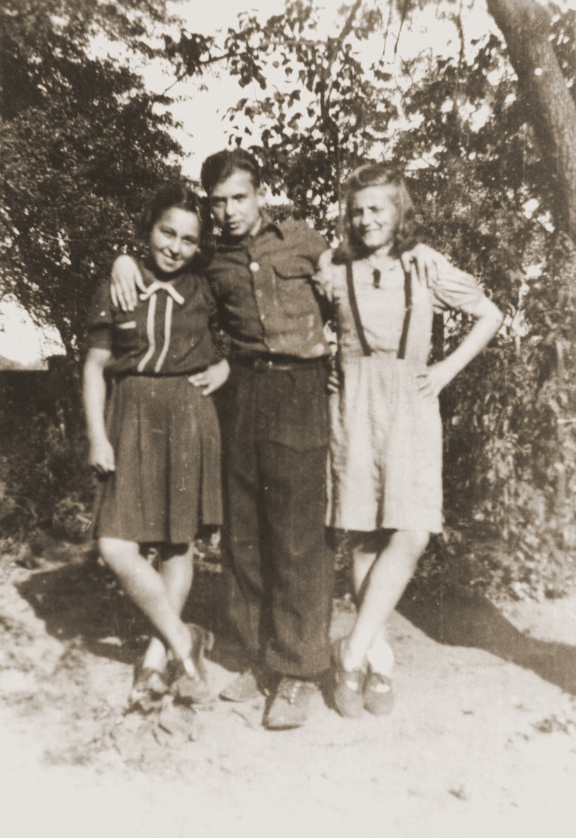 Three teenage orphans pose outside at the Jewish children's home in Gleiwitz, Poland.  Among those pictured is Salusia Goldblum (right).