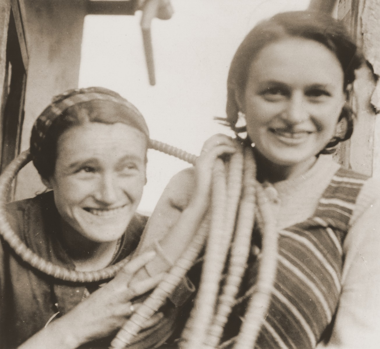 Austrian Jewish refugee sisters in La Paz, Bolivia.  Pictured are Rose Spitzer (left) and Ella Becker (right) with electrical cable.