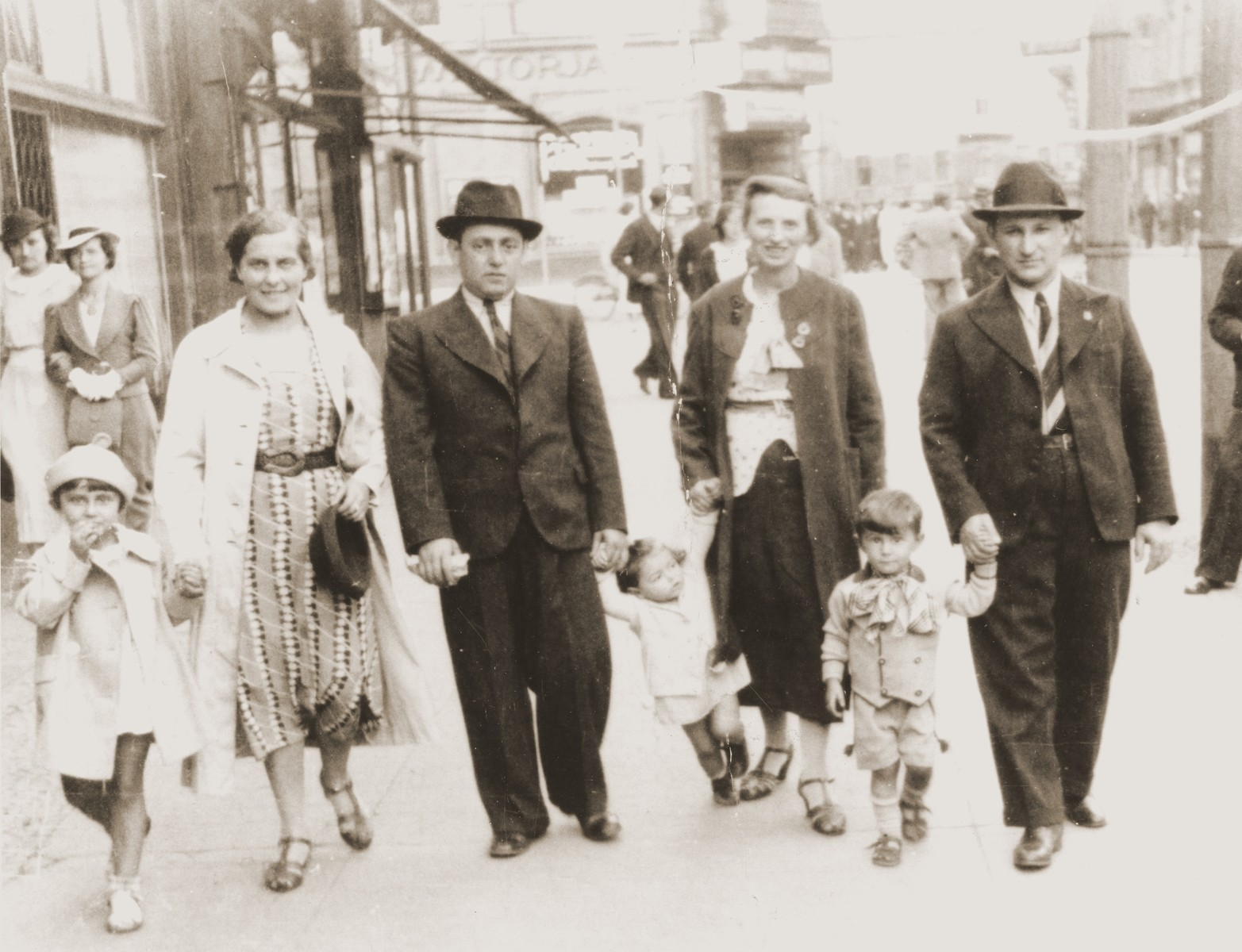 The Goldblum family taking a Sunday stroll on the streets of Katowice.    Salusia and Tola are holding hands on the left, while Izak and Wolf are on the right.