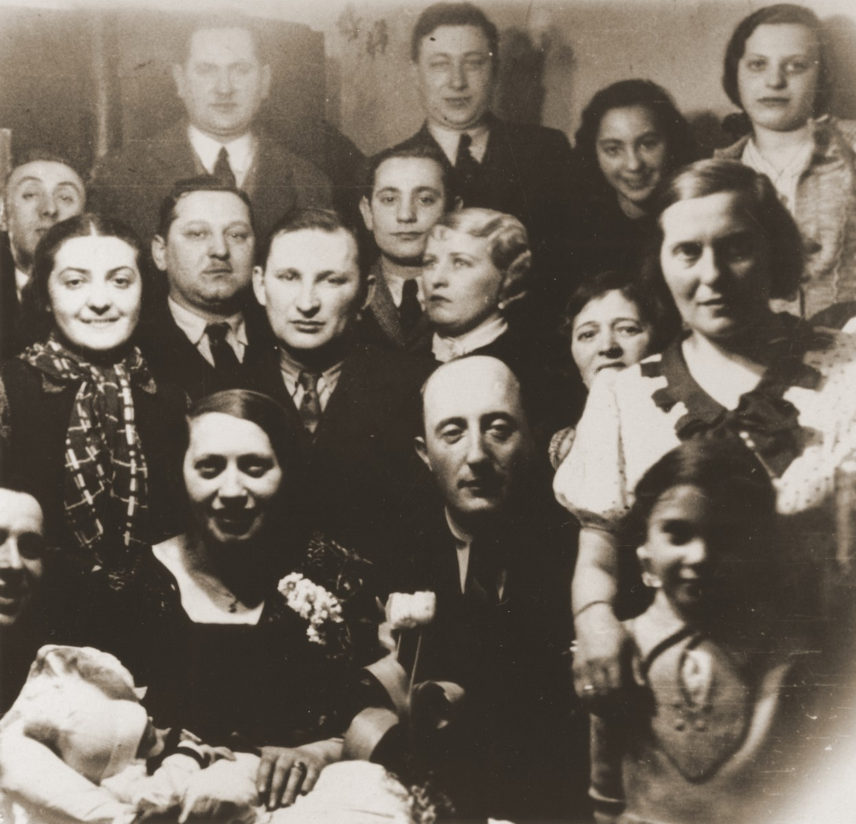 Group portrait of members of the extended Broda family at a gathering to celebrate the birth of the son of Aron and Sheindel Broda in Katowice.  Among those pictured are Aron and Sheindel Broda (front row, center), Tola and Salusia Goldblum (right) and Nacha Broda.