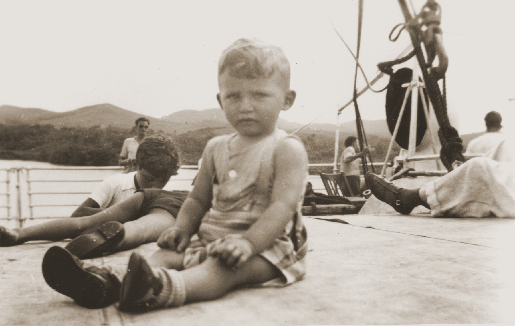 Peter Reis, a Jewish refugee child, sits on the deck of the SS Virgilio near the Panama Canal.