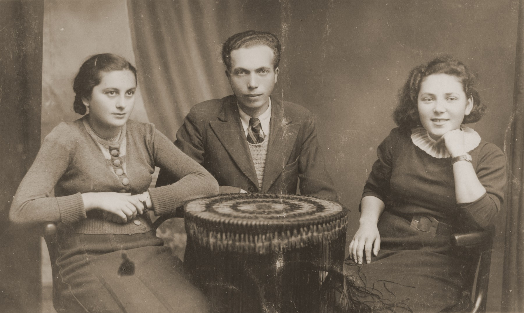 Studio portrait of three Jewish friends in Kanczuga, Poland.  Among those pictured is Basia Gurfein (right).