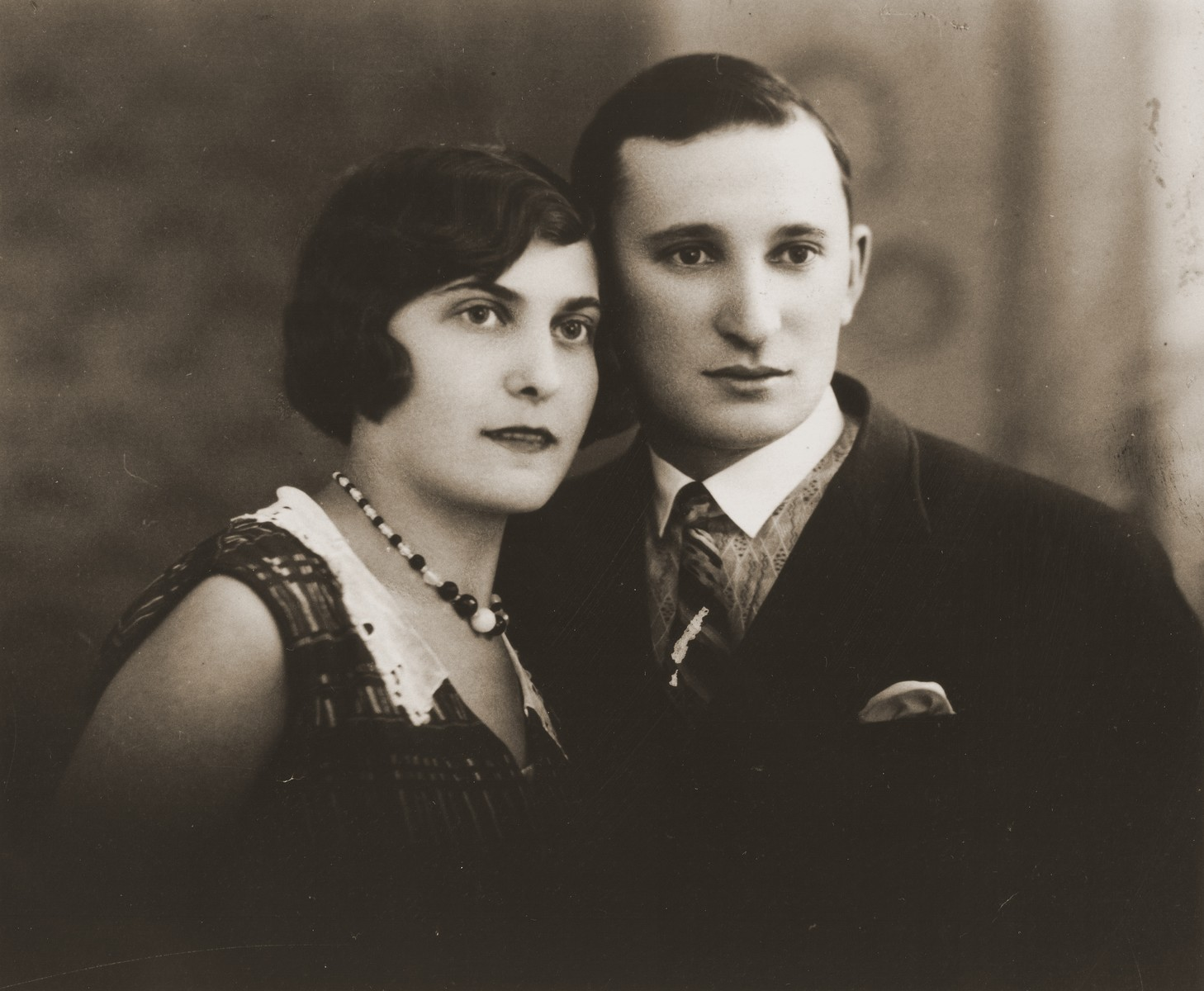 Engagement portrait of Tola Broda and Izak Goldblum.
