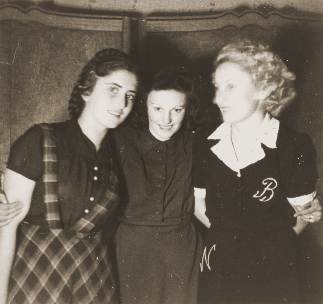 Three young women pose in the Cernauti ghetto.  Pictured from left to right are Erika Neuman, Celine Osterow and Beatrice Neuman.