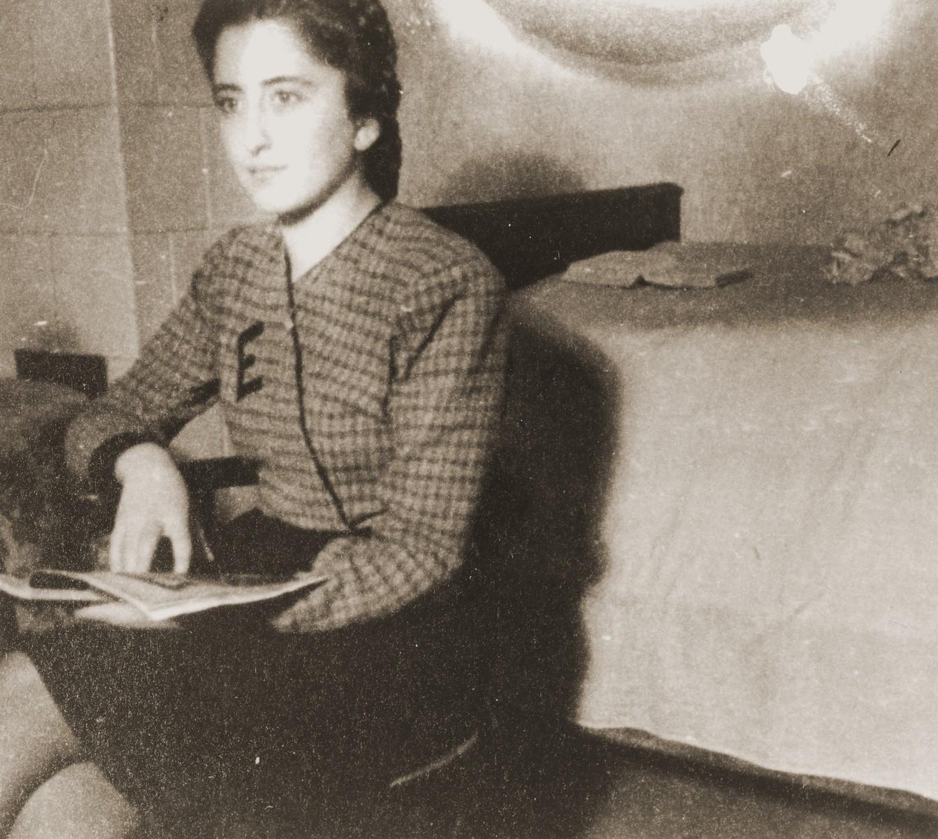 Erika Neuman reads a magazine in the Cernauti ghetto.