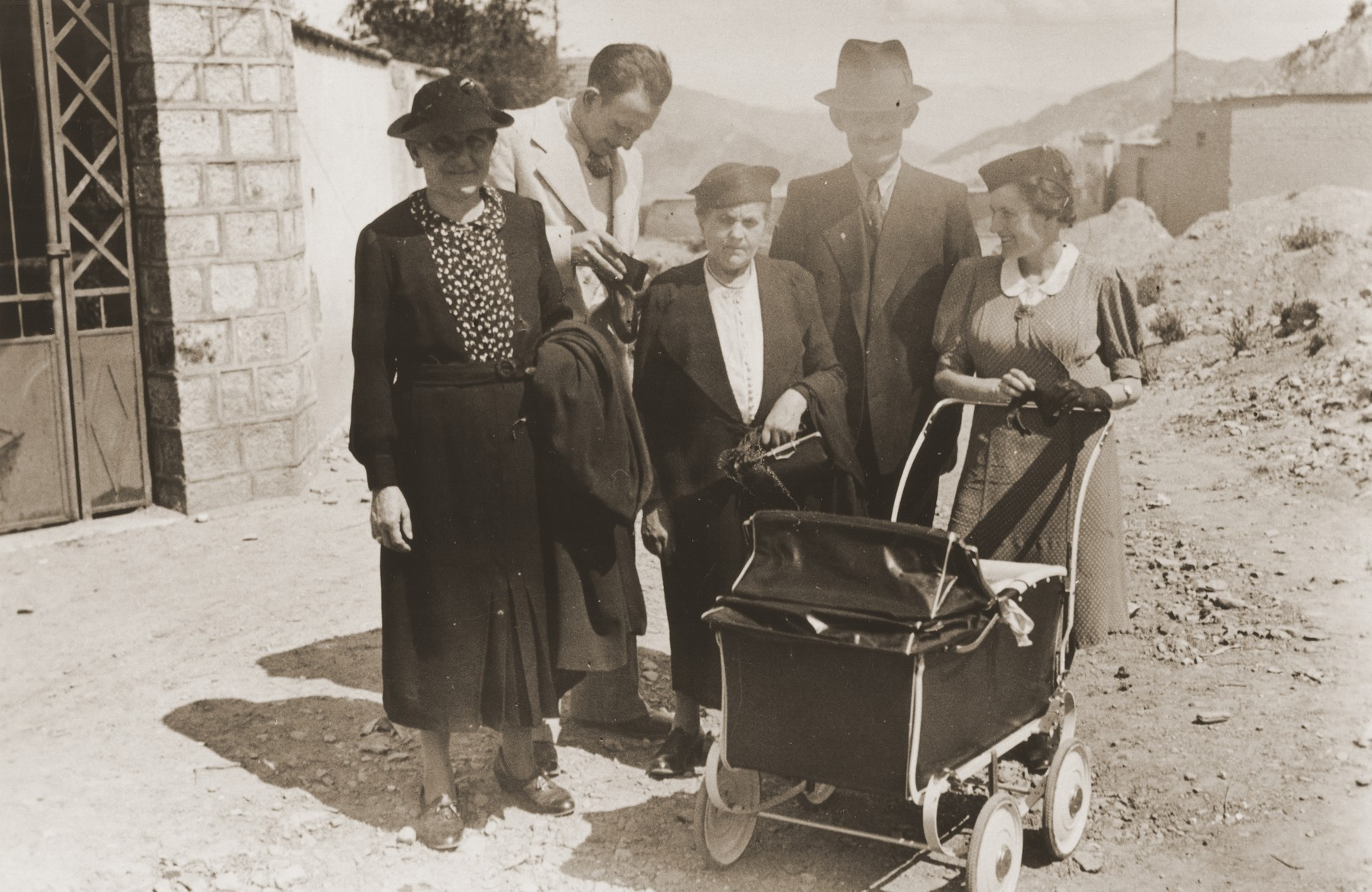 The Wolfinger and Spitzer families outside their home in La Paz, Bolivia.    Pictured from left to right are:  Carolina Spitzer; Eugen Spitzer; Bertha and Nathan Wolfinger; Rosie Spitzer; and Leo Spitzer in the carriage.