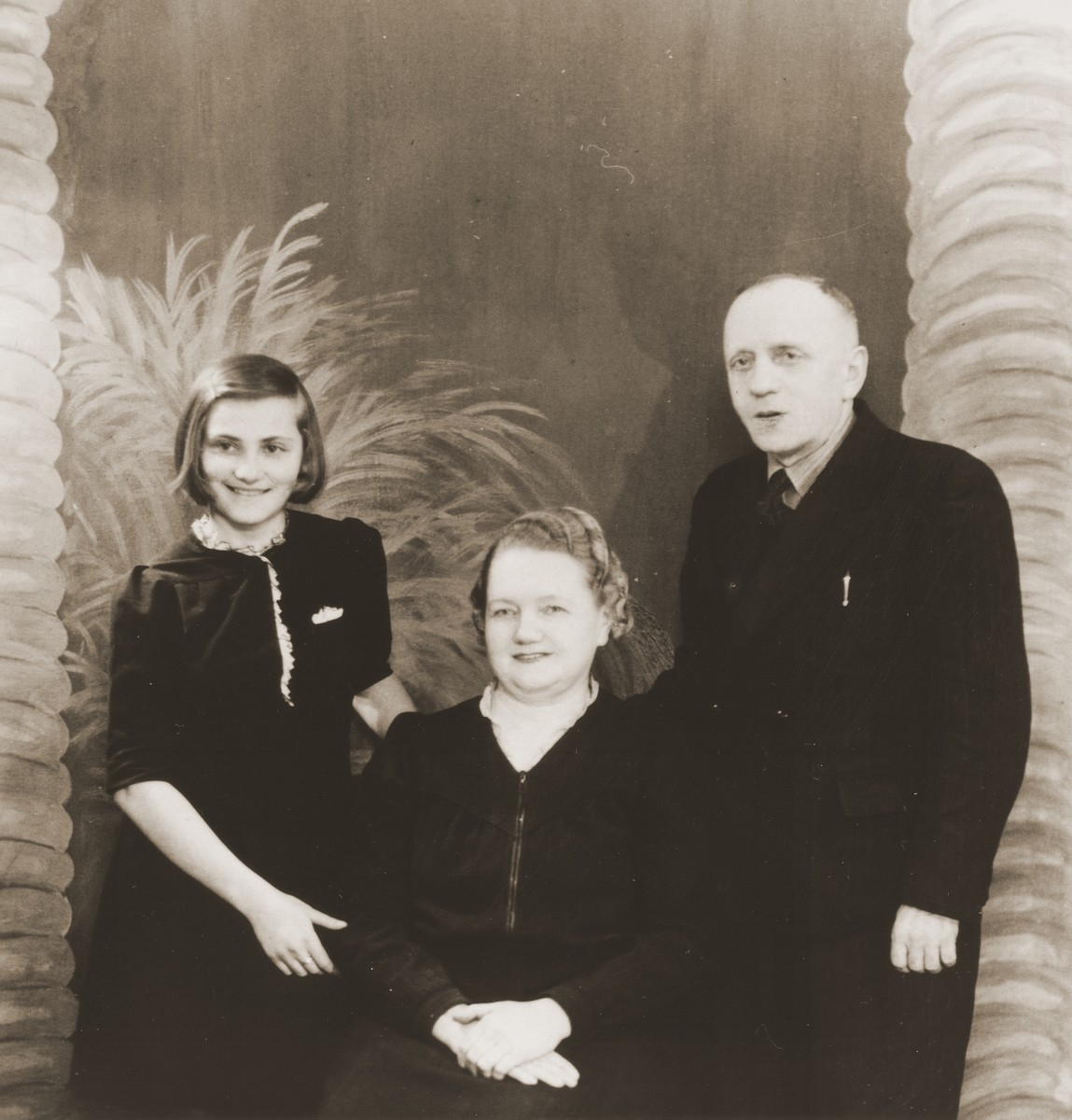 Studio portrait of the Turkin family with their adopted Jewish daughter whom they hid during the war.  Pictured from left to right are Salusia Goldblum, Eva Turkin and Mikolei Turkin.  This photograph was sent by the Turkins to Salusia's relatives in Canada.
