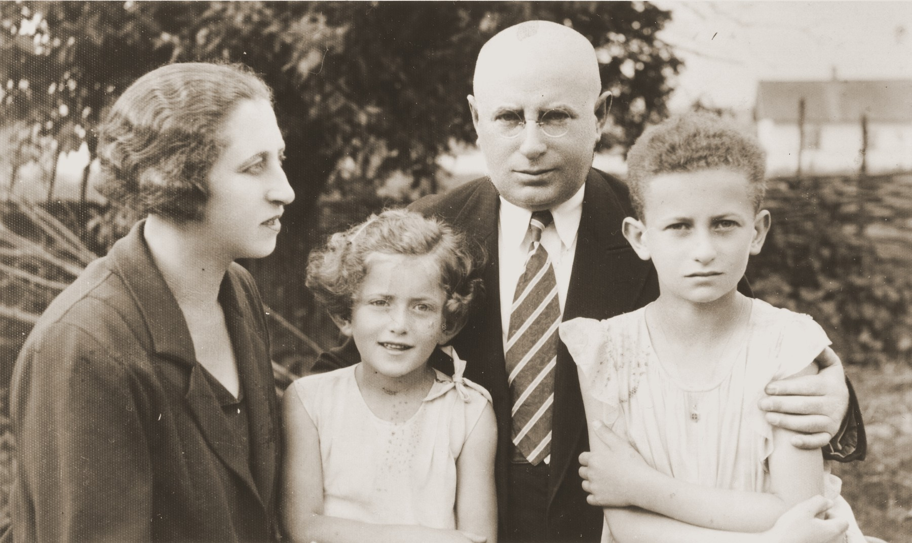 Dolly and Ephraim Neuman with their daughters Beatrice and Erika.