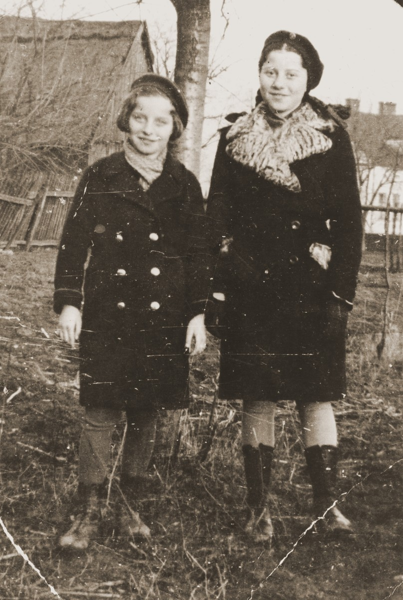 Two Jewish sisters pose outside in Zabno, Poland.  Pictured are Hania and Rachela Goldman.