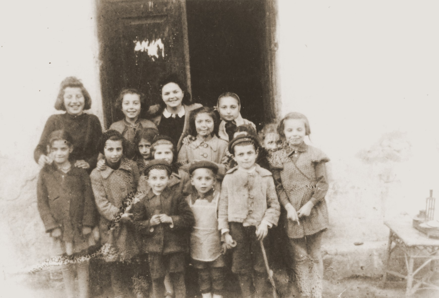 Group portrait of Jewish children in Zabno, Poland.  Among those pictured is Hania Goldman (upper left) and Mala Schwarzberg (top row, center).