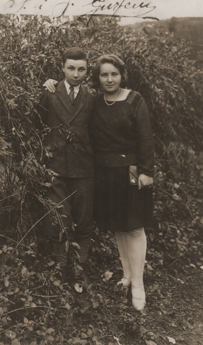 Chaim Yankel Gurfein poses with his sister Sala in a garden in Kanczuga, Poland, on the occasion of his bar mitzvah.
